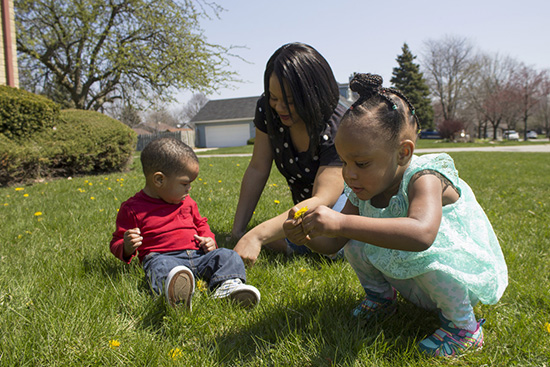 Photo of Shatrece Coleman in park with kids